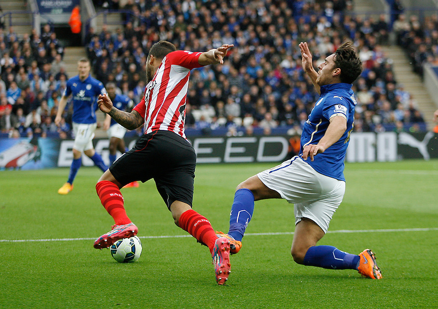 Leicester City's Matthew James (R) appears to injure himself trying to challenge Southampton's Ryan Bertrand <br /> <br /> Photographer Jack Phillips/CameraSport<br /> <br /> Football - Barclays Premiership - Leicester City v Southampton - Saturday 9th May 2015 - King Power stadium - Leicester<br /> <br /> &copy; CameraSport - 43 Linden Ave. Countesthorpe. Leicester. England. LE8 5PG - Tel: +44 (0) 116 277 4147 - admin@camerasport.com - www.camerasport.com
