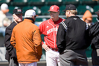 Nebraska coach Mike Anderson meets with Texas Augie Garrido before their game on Sunday March 21st, 2100 at UFCU Dish-Falk Field in Austin, Texas.  (Photo by Andrew Woolley / Four Seam Images)