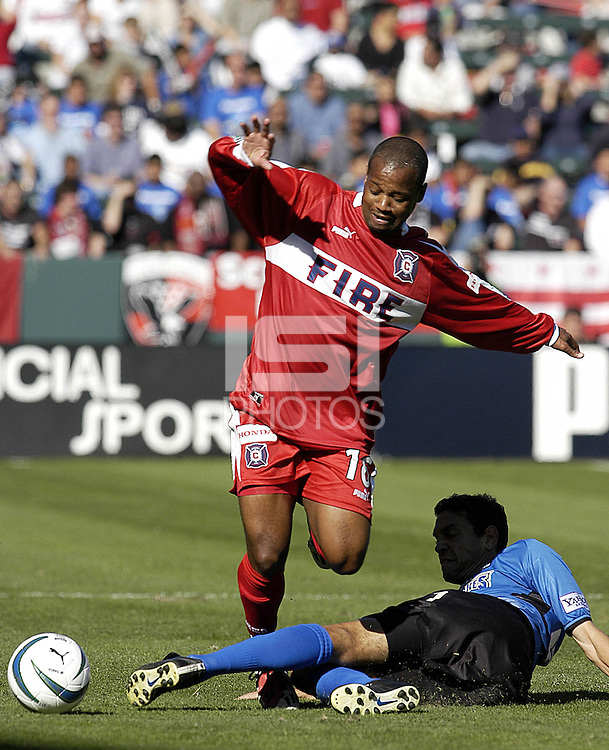 Chicago Fire's Andy Williams loses the ball to a sliding Manny Lagos in the MLS Cup Championship, in Carson, Calif.