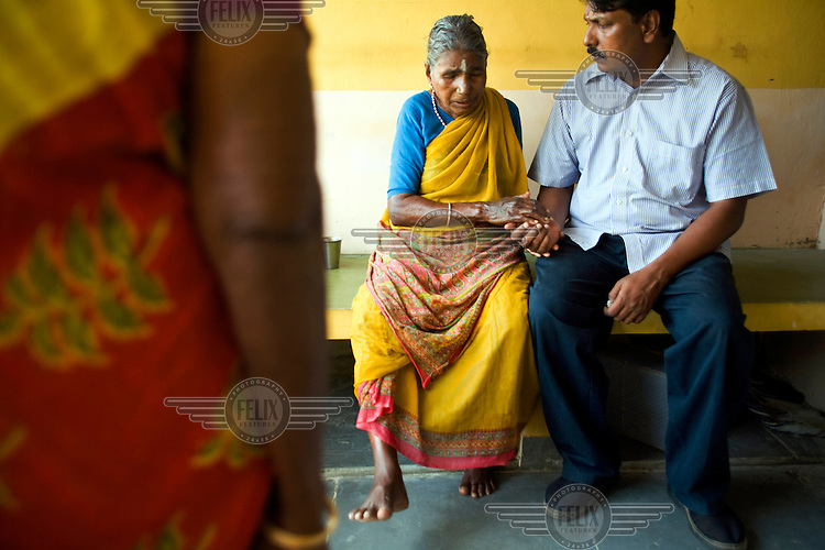 Rajambal, an elderly resident, talks to Saithyababu (Deputy Director of Help Age India in Cuddalore) about her sore ankle at the Tamaraikulum Elders' village. The village is a pioneering experiment initially set up by HelpAge India after the Asian Tsunami to help elderly people displaced by the natural disaster. Today, the village is a self-sustaining community providing a family environment where more able-bodied residents assist the less able-bodied and provides 100 older people with a safe place to live, free healthcare, emotional security, a good diet and professional care and support...