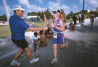 09 NOV 2002 - CANCUN, MEXICO - British Age Group team manager Ian Pettitt hands a flag to Keith Walker at the World Age Group Championships. (PHOTO (C) NIGEL FARROW)
