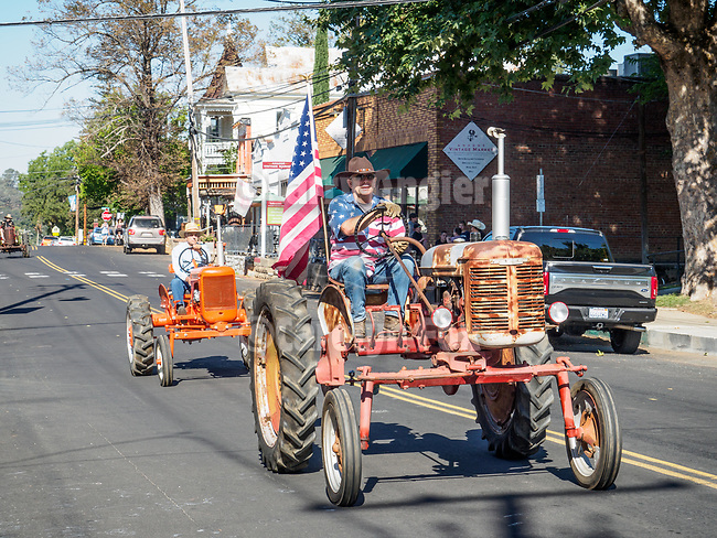 Opening day kids parade on Main Street and ribbon cutting to open the 79th Amador County Fair, Plymouth, Calif.<br /> <br /> Vintage tractors on Main Street<br /> <br /> <br /> #AmadorCountyFair, #PlymouthCalifornia,<br /> #TourAmador, #VisitAmador