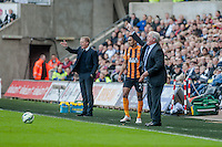 SWANSEA, WALES - APRIL 04: Manager of Swansea City, Garry Monk and Manager of Hull City, Steve Bruce  gesture to players during the Premier League match between Swansea City and Hull City at Liberty Stadium on April 04, 2015 in Swansea, Wales.  (photo by Athena Pictures)