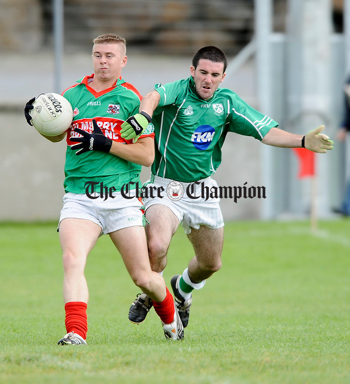 Cathal Lyons of Kilrush moves in on Kilmurry Ibrickane's Noel Downes during their championship game at Cooraclare. Photograph by John Kelly.