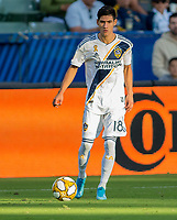 CARSON, CA - SEPTEMBER 29: Uriel Antuna #18 of the Los Angeles Galaxy looks for an open man during a game between Vancouver Whitecaps and Los Angeles Galaxy at Dignity Health Sports Park on September 29, 2019 in Carson, California.
