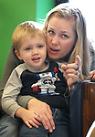 Michelle Pedersen and her son Jack, 3, listen to Storytime at the Carson City Library on Thursday, Dec. 13, 2012. .Photo by Cathleen Allison