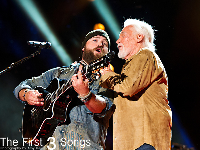Kenny Rogers performs with Zac Brown at LP Field during Day 1 of the 2013 CMA Music Festival in Nashville, Tennessee.