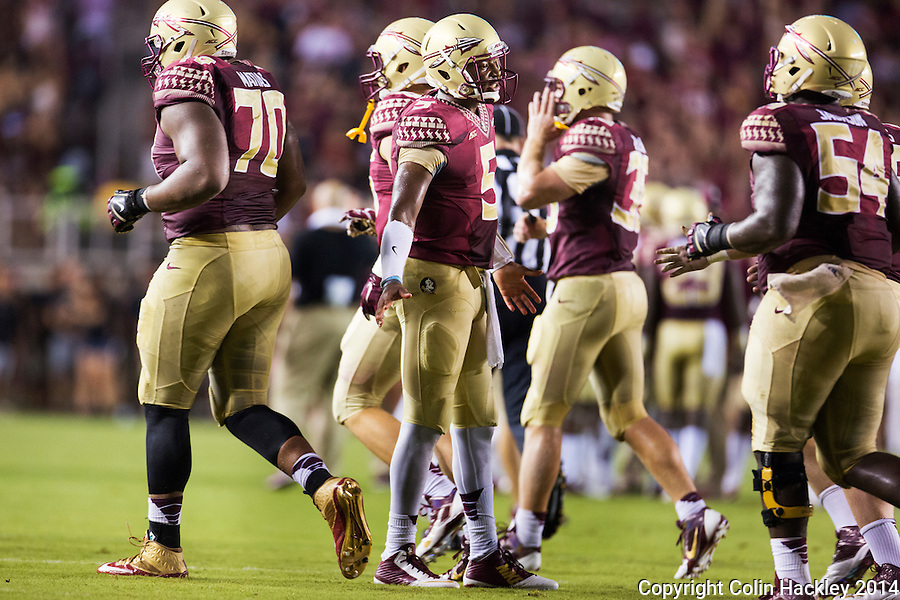 TALLAHASSEE, FL 9/6/14-FSU-CITADEL-Florida State quarterback Jameis Winston, center, celebrates with teammates after a touchdown against the Citadel during first half action Sept. 6, 2014 at Doak Campbell Stadium in Tallahassee. <br /> <br /> COLIN HACKLEY PHOTO