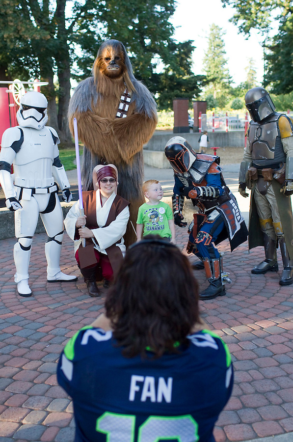 Patricia Davenport takes a photo of her grandson Alan Cobb, 3 with Star Wars characters in Marshall Park in Vancouver Friday July 15, 2016. A star wars movie was shown on the lawn following a Seahawks event. (Photo by Natalie Behring/ for the The Columbian)
