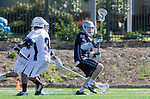 Los Angeles, CA 03/12/16 - Gary Christianson (Utah State #26) and unidentified LMU player(s) in action during the Utah State vs Loyola Marymount MCLA Men's Division I game at Leavey Field at LMU.  Utah State defeated LMU 17-4.