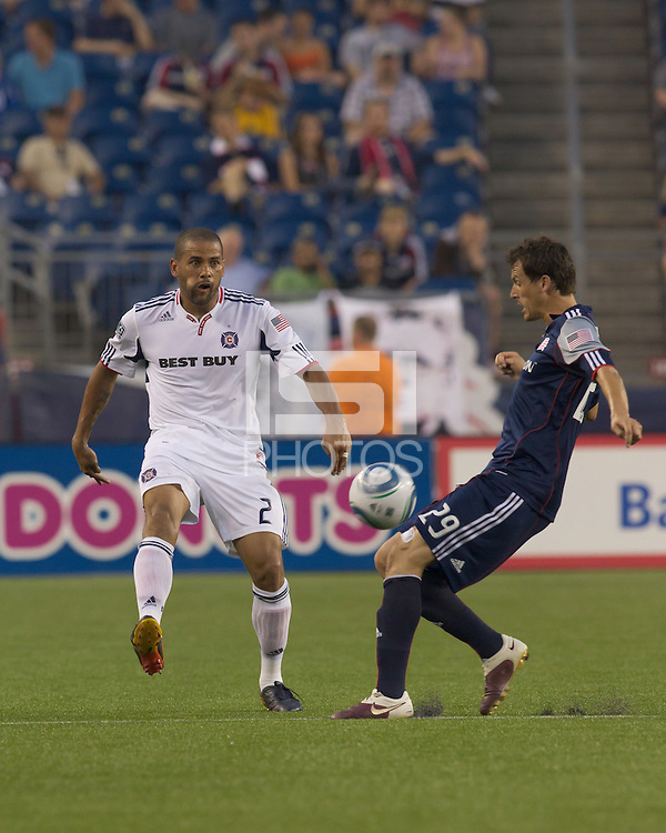 Chicago Fire defender C.J. Brown (2) passes the ball as New England Revolution midfielder Marko Perovic (29) closes. The Chicago Fire defeated the New England Revolution, 1-0, at Gillette Stadium on June 27, 2010.