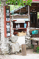 Self service buying of wine and fruit juice at a winery and farm. Potmje village, Dingac wine region, Peljesac peninsula. Dingac village and region. Peljesac peninsula. Dalmatian Coast, Croatia, Europe.