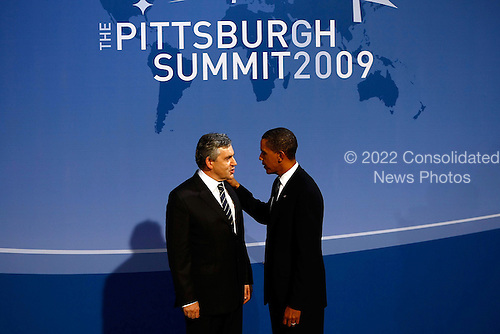 Pittsburgh, PA - September 24, 2009 -- United States President Barack Obama (R) greets British Prime Minister Gordon Brown at the welcoming dinner for G-20 leaders at the Phipps Conservatory on Thursday, September 24, 2009 in Pittsburgh, Pennsylvania. Heads of state from the world's leading economic powers arrived today for the two-day G-20 summit held at the David L. Lawrence Convention Center aimed at promoting economic growth..Credit: Win McNamee / Pool via CNP