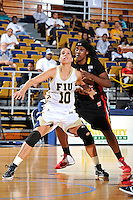 25 November 2011:  FIU guard Fanni Hutlassa (10) boxes out Maryland center Lynetta Kizer (12) in the first half as the University of Maryland Terrapins defeated the FIU Golden Panthers, 84-52, at the U.S. Century Bank Arena in Miami, Florida.