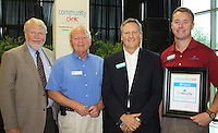 NWA Democrat-Gazette/CARIN SCHOPPMEYER Dan Hawkins, Policy for National Association of Community Health Centers vice president (from left), Warren McDonald, Mike Morgenthaler and Adam Rutledge attend the Community Clinic 20th anniversary breakfast.
