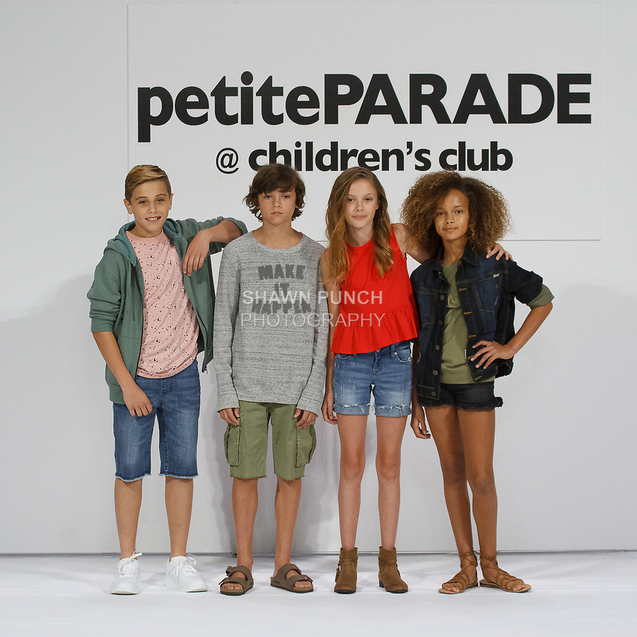 Child models pose on runways in outfits from the collection, during petitePARADE Spring Summer 2018 with Children's Club, at the Javits Center on August 6, 2017. Child models pose on runways in outfits from the Hudson Kids collection, during petitePARADE Spring Summer 2018 with Children's Club, at the Javits Center on August 6, 2017.