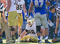 Offensive guard Chris Watt (66) goes down with an injury in the second quarter.