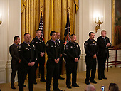 Lieutenant Xavier Torres (Retired); Sergeants Seth Chapman, Terry Smith Jr. (Retired); Thomas Avila III and Rocky Wenrick; Corporal Andrew Rodriguez Sr. (Retired); and Senior Officer Carlos Plascencia (Azusa Police Department, California) and Detective Manuel Campos (Irwindale Police Department, California) of the Azusa Police Department are presented the Medal of Valor in the East Room of the White House in Washington D.C., U.S. for saving civilians' lives during a mass shooting incident on Election Day, 2016.<br /> <br /> Credit: Stefani Reynolds / CNP