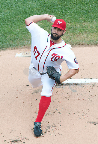Washington Nationals starting pitcher Tanner Roark (57) works in the first inning against the Atlanta Braves at Nationals Park in Washington, D.C. on Sunday, August 14, 2016.<br /> Credit: Ron Sachs / CNP/MediaPunch