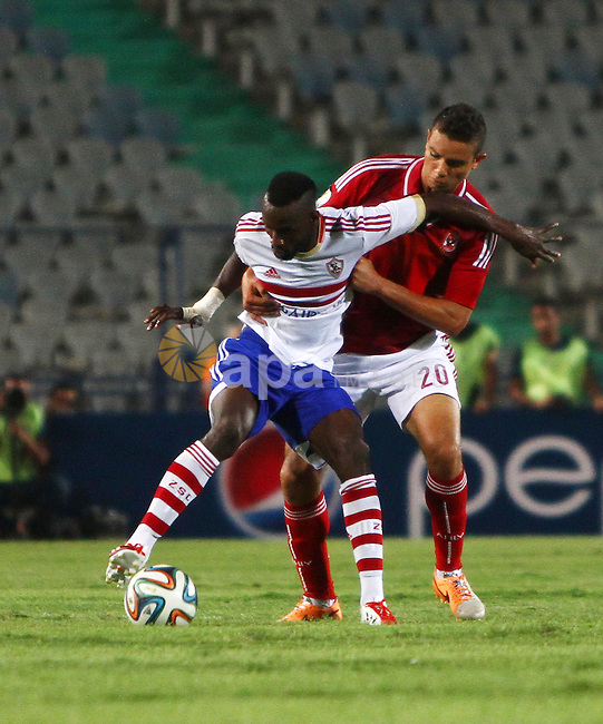 Al Ahly players compete against with Zamalek players during Egyptian Super Cup football match at the Cairo International Stadium, in Cairo, Egypt, Sunday Sept. 14, 2014. The Egyptian football association (EFA) said that fans of Al Ahly and Zamalek clubs will not be allowed to attend the match. The Egyptian football association (EFA) said that fans of Al Ahly and Zamalek clubs will not be allowed to attend the match. Egyptian authorities are limiting the number of soccer fans after the past three years of riots in stadiums. Photo by Mohammed Bendari