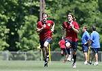Brian McBride (l) and John O'Brien (r) run during a fitness exercise on Wednesday, May 17th, 2006 at SAS Soccer Park in Cary, North Carolina. The United States Men's National Soccer Team held a training session as part of their preparations for the upcoming 2006 FIFA World Cup Finals being held in Germany.