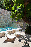A restored wall of provencal stone encloses this courtyard swimming pool and spacious terrace