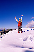 Woman hiking in Snow in Mount Seymour Provincial Park, in the Coast Mountains, North Vancouver, British Columbia, Canada (Model Released)