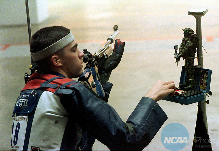 Caption: 7 Mar. 1998: David Fowler of Kentucky reaches for more shells during the Men's and Women's Rifle Championship held at Murray State University. Fowler took eigth place in the smallbore event while Kentucky placed third place in the overall championship . James Glover/NCAA Photos.