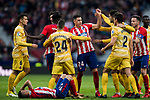 Jose Maria Gimenez de Vargas of Atletico de Madrid confronts with Bernardo Jose Espinosa Zuniga and Juan Pedro Ramirez Lopez, Juanpe, of Girona FC as Angel Correa of Atletico de Madrid lies injured on the pitch during the La Liga 2017-18 match between Atletico de Madrid and Girona FC at Wanda Metropolitano on 20 January 2018 in Madrid, Spain. Photo by Diego Gonzalez / Power Sport Images