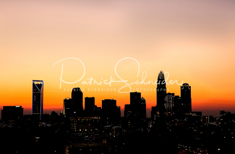 Silhouette of the Charlotte skyline at dusk as the sun sets in the horizon. Taken in July 2010. Buildings shown in the background include the new Duke Energy Center tower (far left), One Wachovia Center, the Hearst Tower (far right), and Bank of America Corporate Center (tallest).