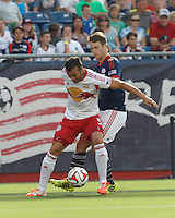 Foxborough, Massachusetts - June 8, 2014: First half action. In a Major League Soccer (MLS) match, the New England Revolution (blue/white) vs New York Red Bulls (white/red), 0-1 (halftime), at Gillette Stadium.