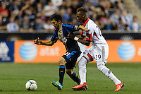 Michael Farfan (21) of the Philadelphia Union is marked by Michael Seaton (29) of D. C. United. The Philadelphia Union defeated D. C. United 2-0 during a Major League Soccer (MLS) match at PPL Park in Chester, PA, on August 10, 2013.