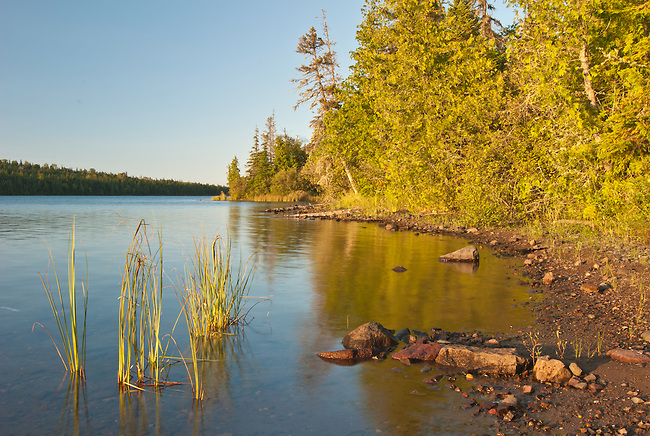 The sun sets of the shore of Tobin Lake on Isle Royale, Isle Royale National Park, Keweenaw County, Michigan