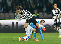 Andrea Pirlo   Jorginho   in action during the Italian Serie A soccer match between SSC Napoli and Juventus FC   at San Paolo stadium in Naples, March 30 , 2014