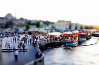 The sunset on Bosphorus is seen from the Galata Bridge in Istanbul, Turkey.