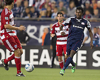 New England Revolution forward Kenny Mansally (7) passes the ball. In a Major League Soccer (MLS) match, the New England Revolution defeated FC Dallas, 2-0, at Gillette Stadium on September 10, 2011.