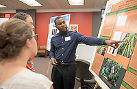 "Marvin Browne '16 presents his research on ""Characterization of Nutrient Uptake in Tank Bromeliads."" After researching all summer, Occidental College students present their work at the annual Summer Undergraduate Research Conference on July 29, 2015.<br /> (Photo by Marc Campos, Occidental College Photographer)"