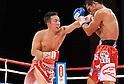 (L-R) Takahiro Aou (JPN), Terdsak Kokietgym (THA),.APRIL 6, 2012 - Boxing :.Takahiro Aou of Japan hits Terdsak Kokietgym of Thailand during the WBC super featherweight title bout at Tokyo International Forum in Tokyo, Japan. (Photo by Mikio Nakai/AFLO)