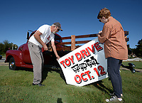 NWA Democrat-Gazette/ANDY SHUPE<br /> Clem and Kim Johnson work together Tuesday, Oct. 8, 2019, to decorate a 1952 Chevrolet truck ahead of the ninth annual Toy Drive and Classic Car Cruise-In planned for 2 p.m. Saturday at Tuba Trucks at 1798 E. Huntsville Road in Fayetteville. Attendees will be treated to barbecue and music and are asked to bring a new toy or wrapping paper and tape to benefit children at Asbell Elementary School. Last year's effort collected three truck loads of toys.