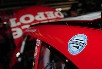 May 1, 2009; Richmond, VA, USA; A decal in memory of long time writer David Poole is displayed on the car driven by NASCAR Sprint Cup Series driver Tony Stewart during practice for the Russ Friedman 400 at the Richmond International Raceway. Poole died last week of a heart attack. Mandatory Credit: Mark J. Rebilas-