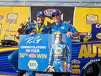 Aug 20, 2016; Brainerd, MN, USA; NHRA funny car driver Ron Capps (left) celebrates with crew chief Rahn Tobler after winning the Protect the Harvest Nationals from Seattle, WA that was delayed by rain to run during qualifying for the Lucas Oil Nationals at Brainerd International Raceway. Mandatory Credit: Mark J. Rebilas-USA TODAY Sports