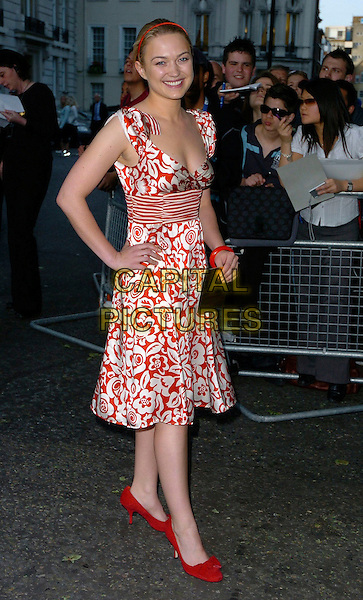 SOPHIA MYLES.Glamour magazine's 3rd Annual Woman of the Year Awards Berkeley Square Gardens - Arrivals, London, UK. .June 6th, 2006 .Ref: CAN.full length red dress floral print shoes hand on hip.www.capitalpictures.com.sales@capitalpictures.com.©Capital Pictures