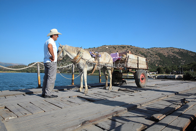 Man with a horse and cart using the Butrint Cable Ferry to cross the Vivari Channel, Butrint, Chaonia, Albania. Picture by Manuel Cohen