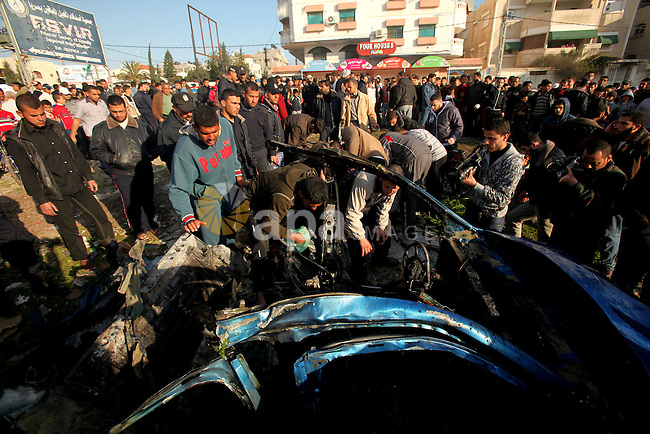Palestinians look at the remains of a vehicle after it exploded in Gaza City March 9, 2012. Israel killed the leader of a Palestinian militant faction on Friday in a targeted attack on the car in the Gaza Strip, an Israeli official said. A second man also died in the blast, and a third was injured. The attack came shortly after two rockets were fired at Israel from the coastal territory, causing no damage or injury. Photo by Yasser Qudeh