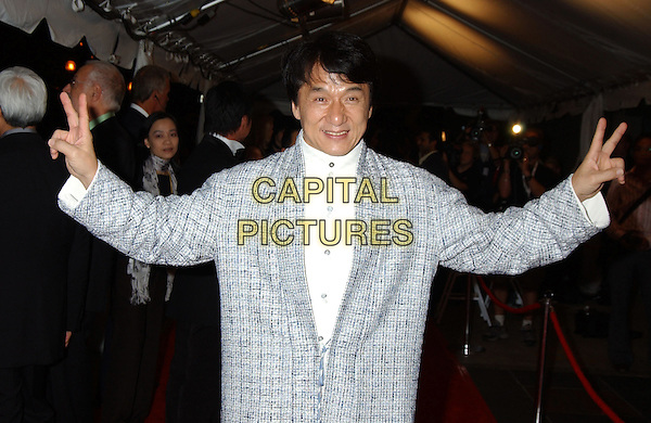 "JACKIE CHAN.At the 'The Myth' premiere held at Roy Thomson Hall,.At The Toronto Film Festival,.Toronto, 15th September 2005.half length white shirt blue jacket fingers gesture peace sign hands.Ref"" ADM/LF.www.capitalpictures.com.sales@capitalpictures.com.© Capital Pictures."