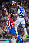 Raul Rodriguez Navas (R) of Real Sociedad fights for the ball with Stefan Savic (L) of Atletico de Madrid during their La Liga match between Atletico de Madrid vs Real Sociedad at the Vicente Calderon Stadium on 04 April 2017 in Madrid, Spain. Photo by Diego Gonzalez Souto / Power Sport Images