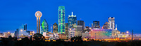 This is an panorama of the Dallas Skyline after dark with only the light from the high rise skyscrapers in view in the downtown area.  This cityscape has all the usual iconic dallas buildings like the Reuion Tower, Heritage Plaza, Fountain Place, Bank of America, to the alway colorful Omni Hotel in view.