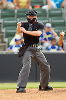 Home plate umpire Junior Valentine makes a strike call during the South Atlantic League game between the Rome Braves and the Kannapolis Intimidators at CMC-Northeast Stadium on August 5, 2012 in Kannapolis, North Carolina.  The Intimidators defeated the Braves 9-1.  (Brian Westerholt/Four Seam Images)