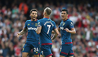West Ham United's Marko Arnautovic celebrates scoring his side's first goal with Ryan Fredericks and Fabian Balbuena<br /> <br /> Photographer Rob Newell/CameraSport<br /> <br /> The Premier League - Arsenal v West Ham United - Saturday August 25th 2018 - The Emirates - London<br /> <br /> World Copyright © 2018 CameraSport. All rights reserved. 43 Linden Ave. Countesthorpe. Leicester. England. LE8 5PG - Tel: +44 (0) 116 277 4147 - admin@camerasport.com - www.camerasport.com