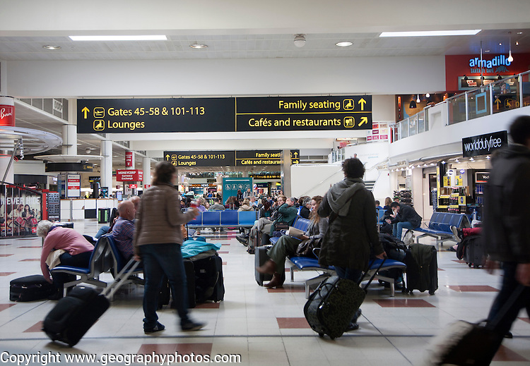 People waiting in departure lounge at Gatwick airport, England